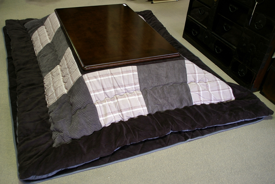 A Kotatsu Is A Low, Wooden Table Frame Covered By A Futon Or Heavy Blanket,  Upon Which A Table Top Sits. Underneath Is A Heat Source, Often Built Into  The ...